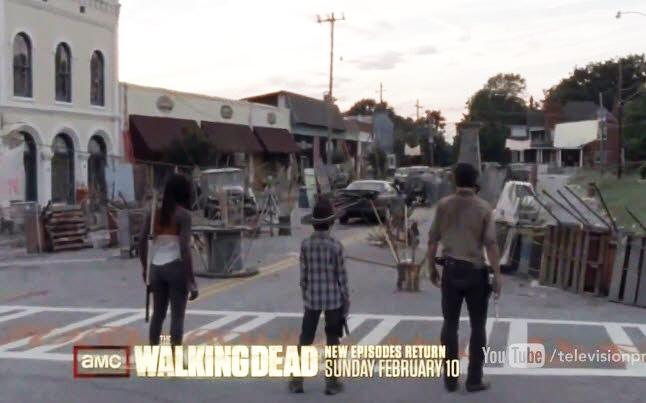 Rick, Michonne, and Carl enter Woodbury