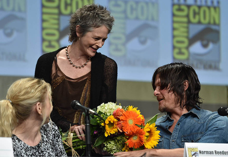 At The Walking Dead 2014 SDCC Panel Melissa McBride Gives Flowers to Norman Reedus