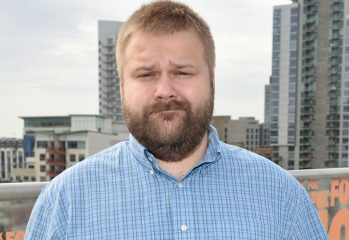 """Executive producer Robert Kirkman attends AMC's """"The Walking Dead"""" breakfast on Day 2 of Comic-Con International on Friday, July 25, 2014, in San Diego. (Photo by John Shearer/Invision for AMC/AP Images)"""